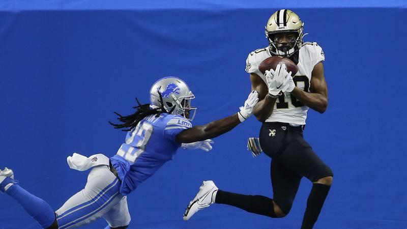 New Orleans Saints wide receiver Tre'Quan Smith, defended by Detroit Lions cornerback Desmond...