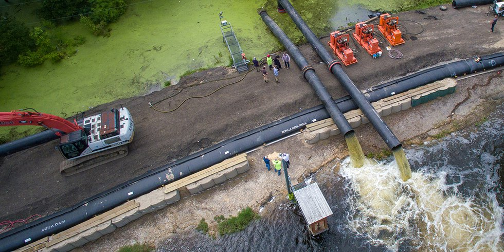 Pumps are being used to move water Spanish Lake/Bluff Swamp across Alligator Bayou Road into...