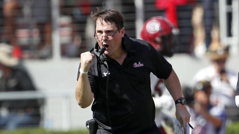 South Carolina head coach Will Muschamp reacts after his team returned an interception of a...