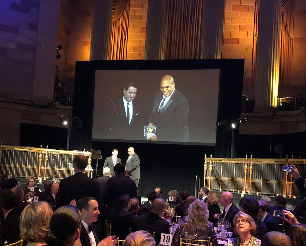 Robert Hollins accepts his Murrow award at the ceremony Monday night