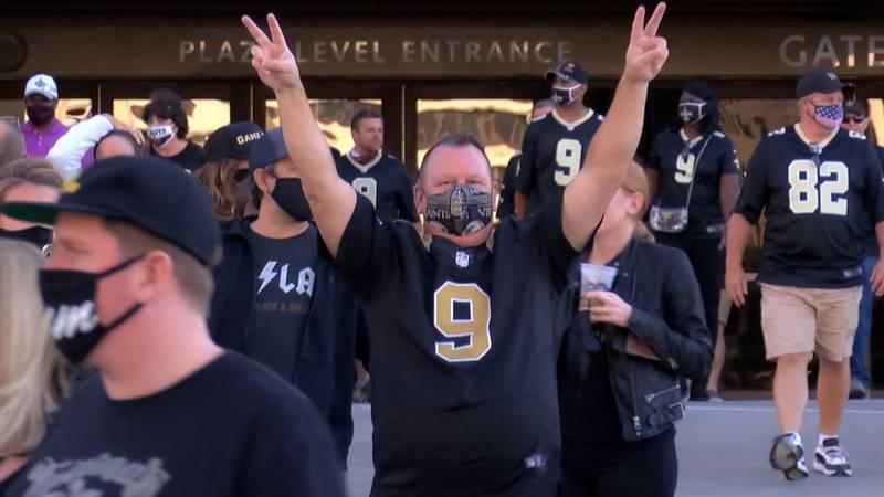 Saints fans celebrate a victory over longtime rival, the Atlanta Falcons on Nov. 22, 2020.