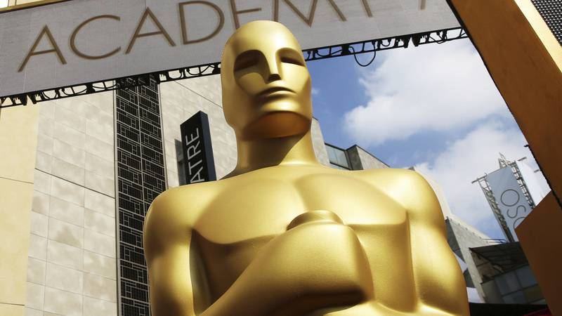 FILE - In this Feb. 21, 2015 file photo, an Oscar statue appears outside the Dolby Theatre for...