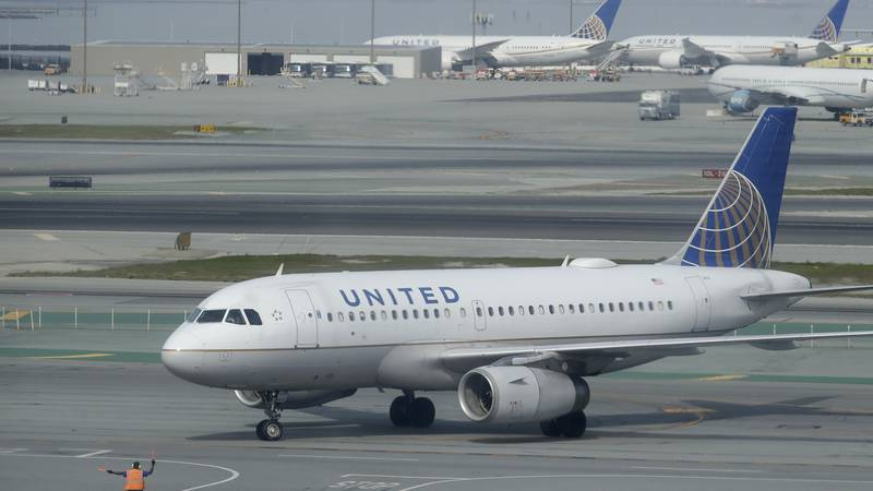 A United Airlines plane is shown on the tarmac from an outdoor terrace and observation deck at...