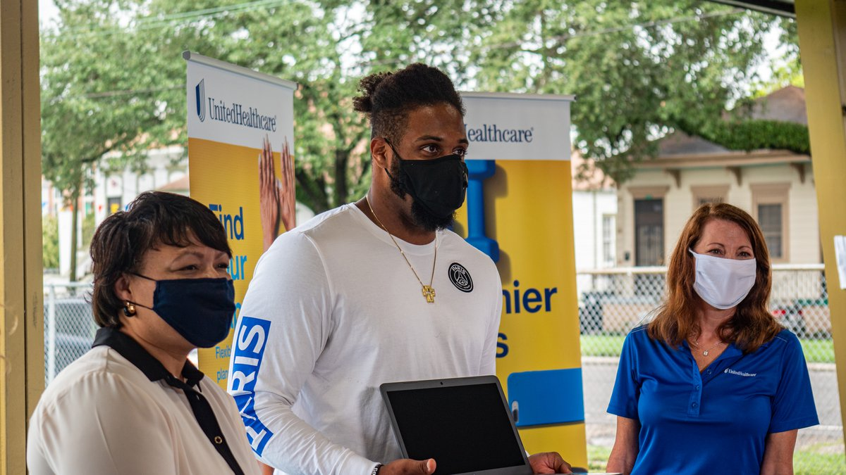 Saints defensive end Cam Jordan teams up with New Orleans Mayor LaToya Cantrell to hand out...