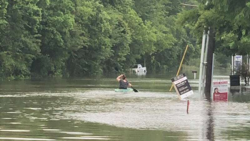 Some people living in the Kenilworth Ridge Apartment near Burbank Drive had to use boats and...