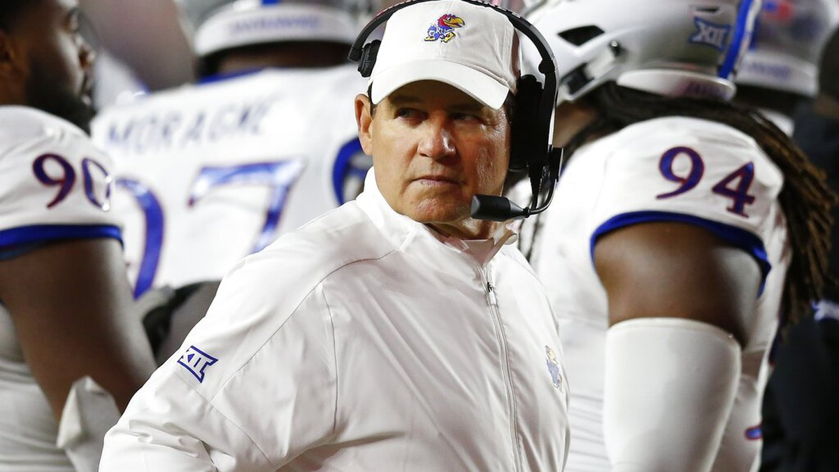 FILE - In this Sept. 13, 2019, file photo, Kansas coach Les Miles stands with his team during a...