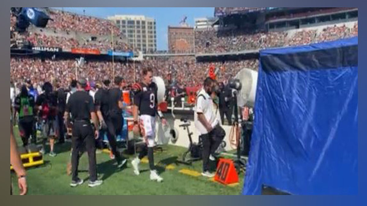 Joe Burrow walks to the blue tent after taking a huge hit.