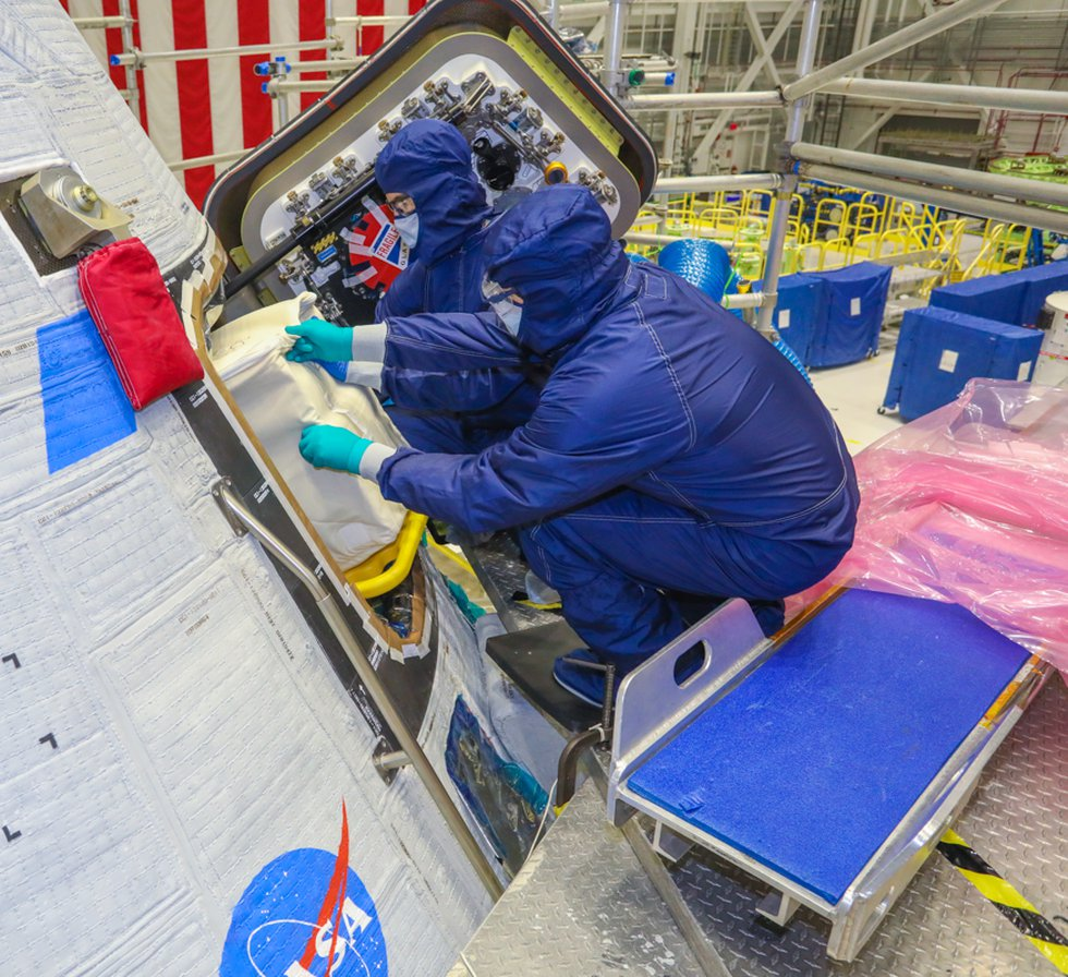 Cargo is packed into the Starliner spacecraft at the Commercial Crew and Cargo Processing...