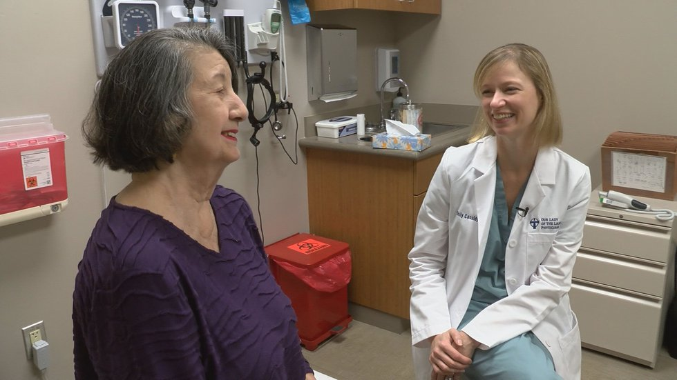 Lung cancer survivor, Olga (left), speaks with Mary Bird Perkins – Our Lady of the Lake Cancer...