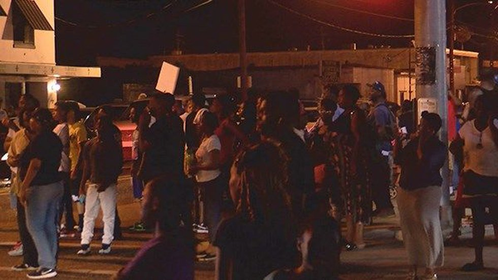 Hundreds gathered outside a convenience store that was the scene where police shot and killed a...