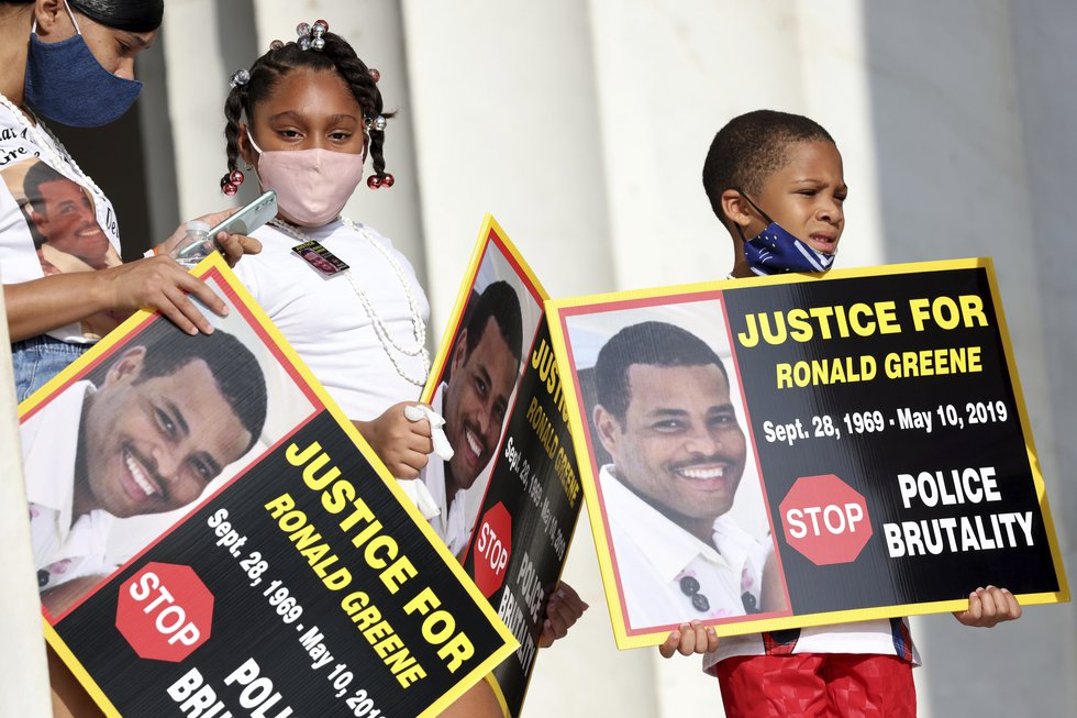 FILE - In this Aug. 28, 2020 file photo, family members of Ronald Greene listen to speakers as...