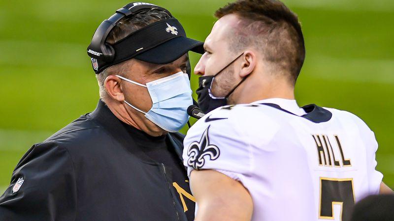 Saints head coach Sean Payton talks with quarterback Taysom Hill during a game.