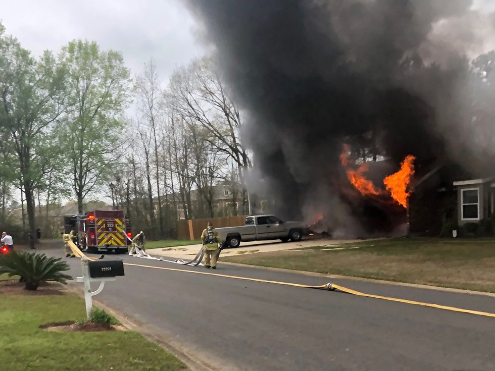 Propane tanks in the car port exploded, sending neighbors into a frenzy.