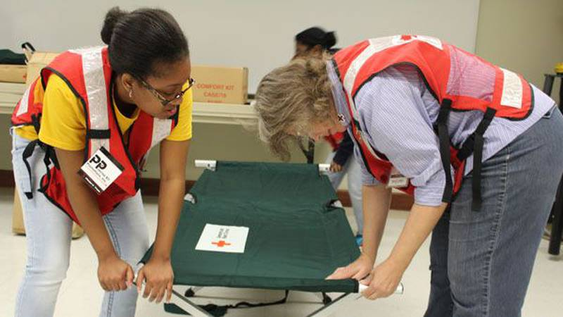 Red Cross volunteers work to set up a shelter for flood victims in South Louisiana. (Source WAFB)