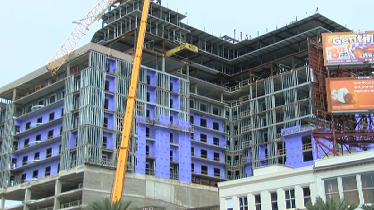 City officials work to secure demolished crane