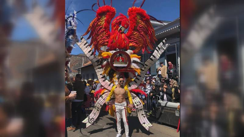 The elaborate costumes feature huge sculptural pieces that member wear on their backs.