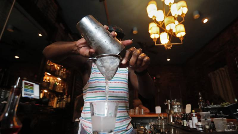 FILE - In this Thursday, July 9, 2020 file photo, a bartender makes a cocktail in New Orleans....