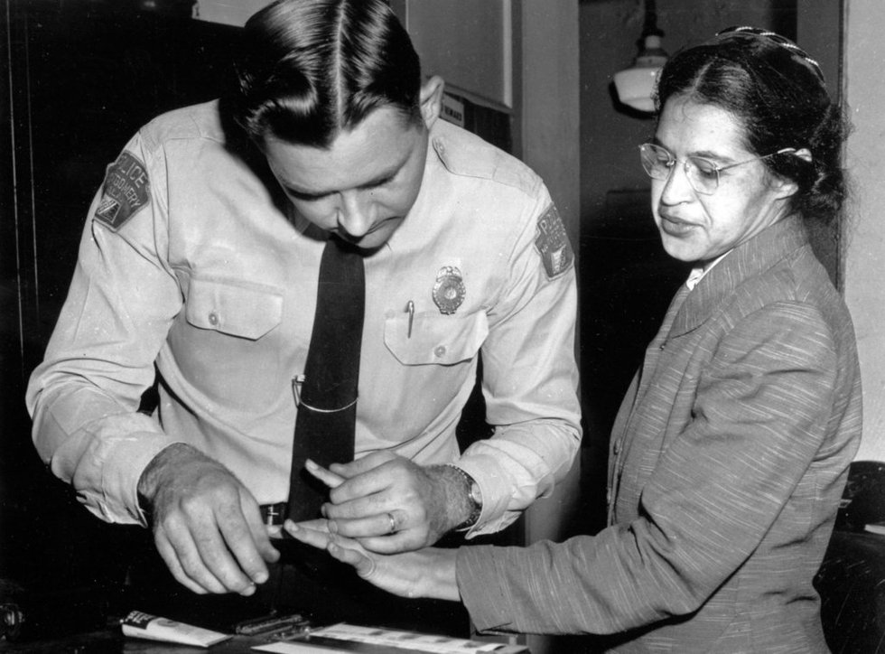 FILE - In this Feb. 22, 1956, file photo, Rosa Parks is fingerprinted by police Lt. D.H. Lackey...