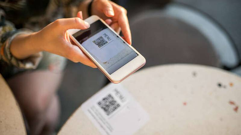 woman scanning qr code for online menu