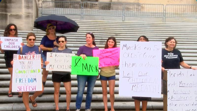 Parents gathered on the steps of the Louisiana State Capitol on Tuesday, Aug. 3, 2021, to...