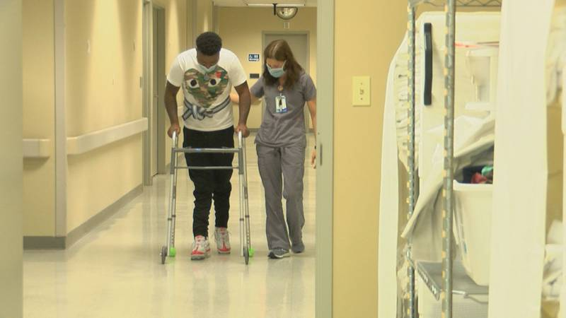 Devin Puckett walks again after he was accidentally shot in the spine.