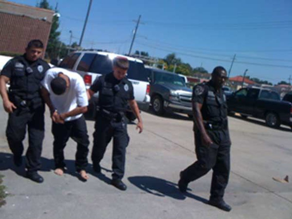 Jackson is led to the St. Bernard Parish Prison (Source: WWL-TV in New Orleans, LA)
