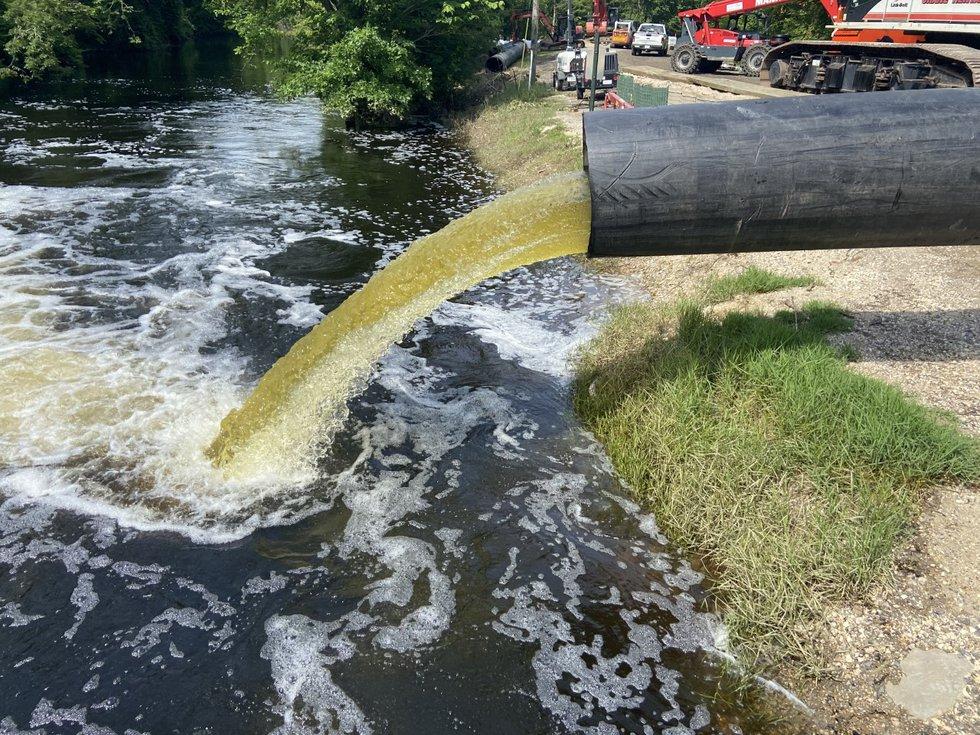 Crews cut Alligator Bayou Rd. to allow the Bluff Swamp/Alligator Bayou/Fish Bayou to drain into...