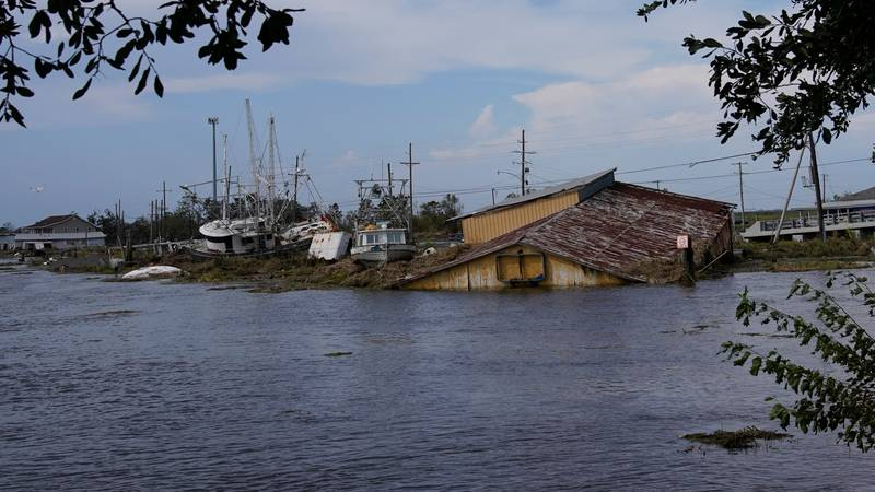 Flood damaged buildings and boats in the aftermath of Hurricane Ida, Wednesday, Sept. 1, 2021,...
