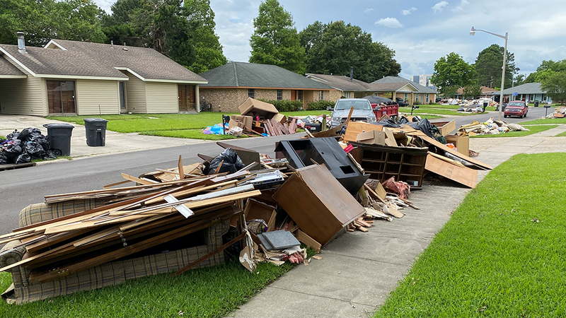 Piles of debris sit outside homes in East Baton Rouge Parish that had flooding due to heavy...