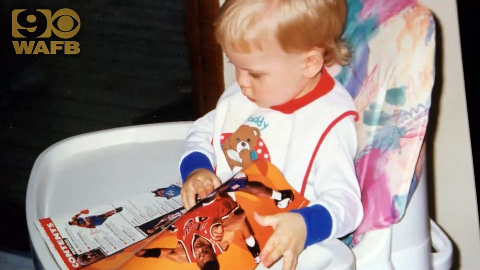 Joe Burrow as an infant looks at an issue of Sports Illustrated in the late 1990s, nearly 20...