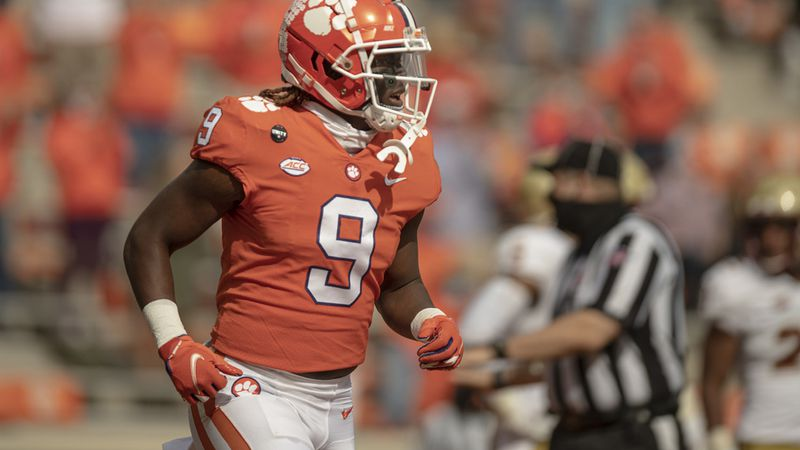 Clemson running back Travis Etienne(9) runs back to the sidelines after scoring during the...