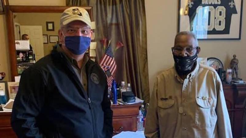 Gov. John Bel Edwards and Lawrence Brooks, the world's oldest living WWII veteran