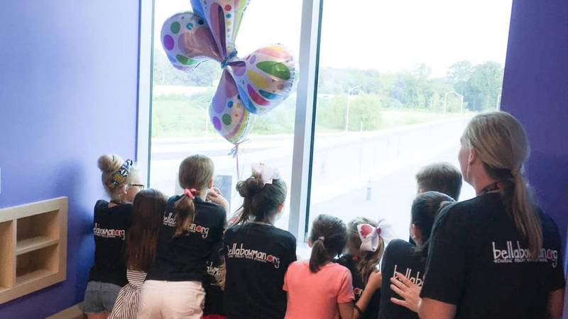 Friends of the Bella Bowman Foundation look out the hospital window where the Bowman house can...