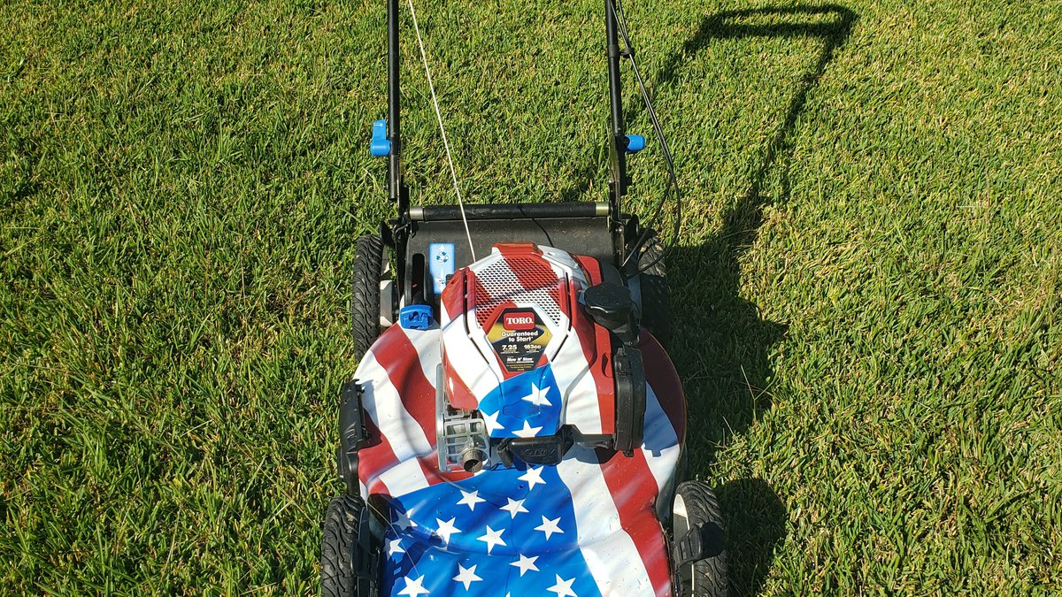 Smith is mowing lawns all across the country with his brightly colored lawnmower decorated like...