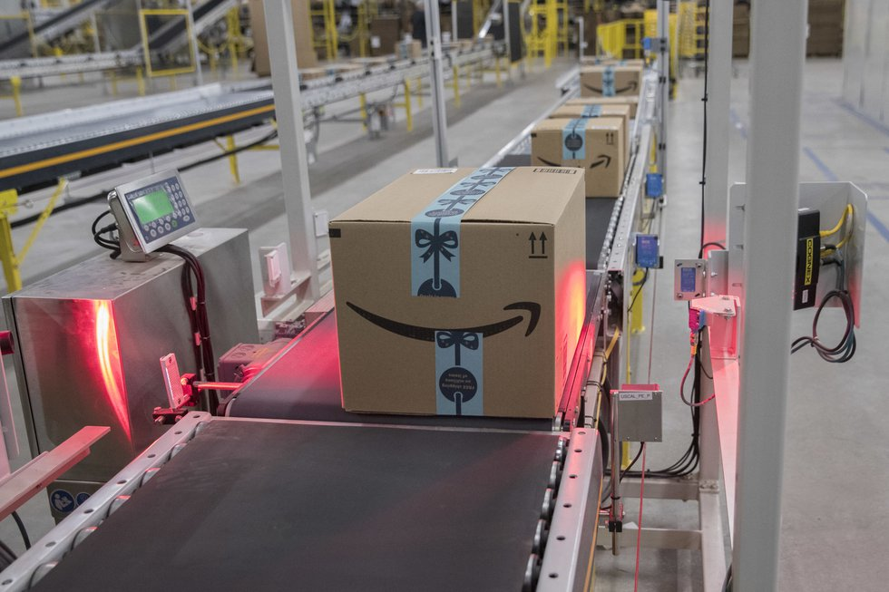 In this Dec. 5, 2018, photo a box is scanned and weighed before at the Amazon fulfillment...