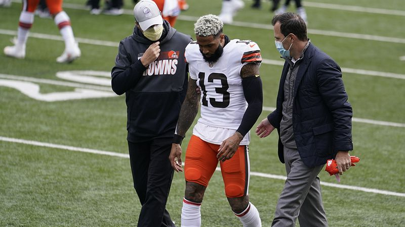 Cleveland Browns wide receiver Odell Beckham Jr. (13) is helped off the field in the first half...
