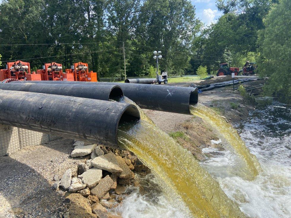 Crews cut Alligator Bayou Rd to allow the Bluff Swamp/Alligator Bayou/Fish Bayou to drain into...