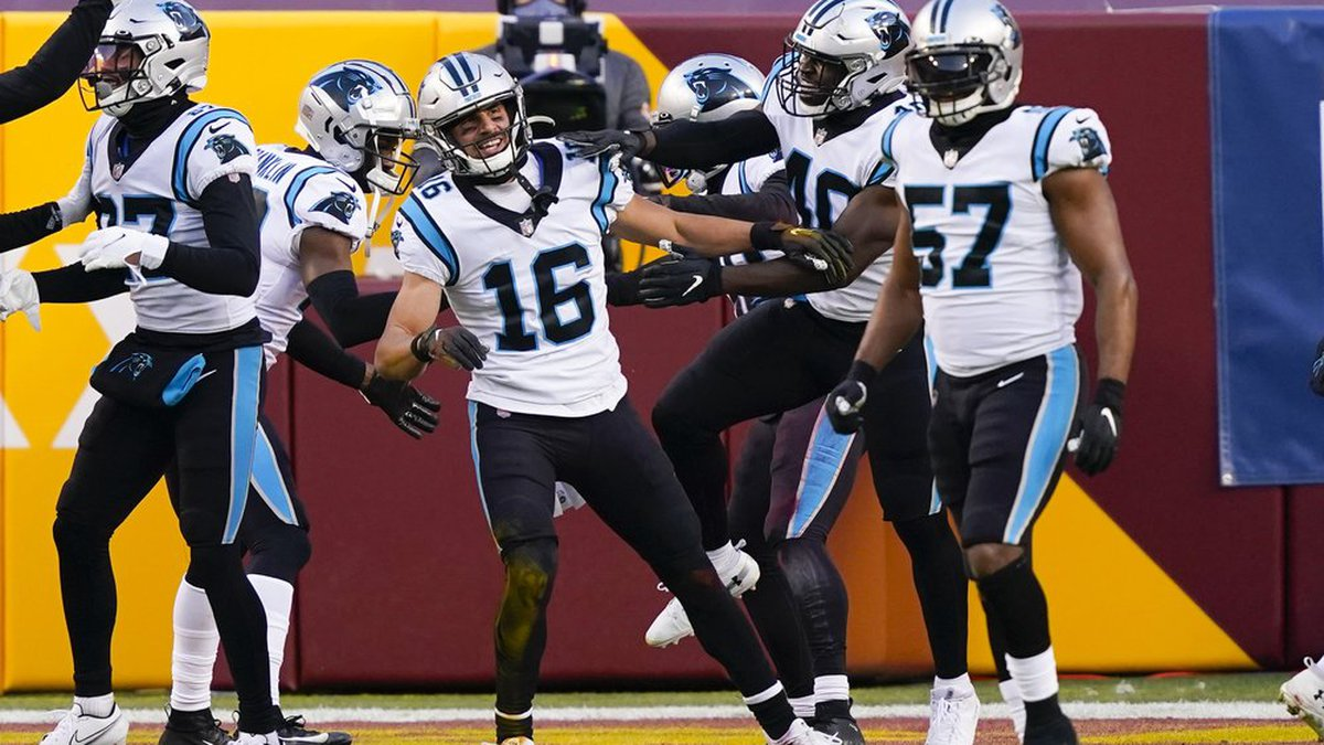 Carolina Panthers wide receiver Brandon Zylstra (16) is surround by teammates after scoring a...