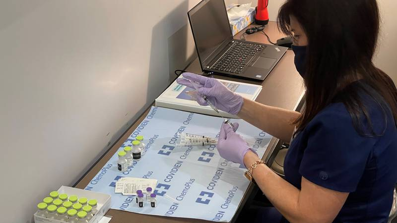 An OLOL Pharmacist preps doses of the Pfizer vaccine for distribution to patients