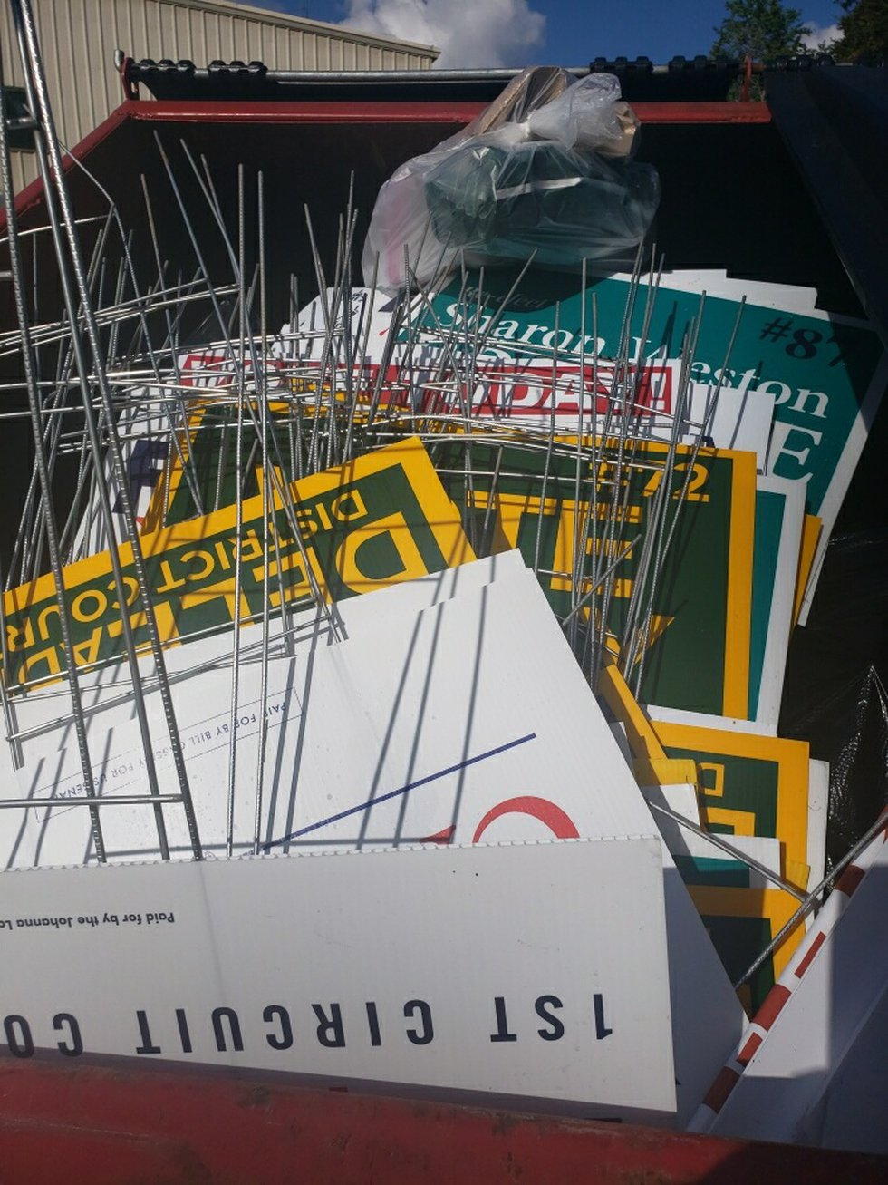 These campaign signs appear to have been pulled out the ground and thrown away in a trash can...