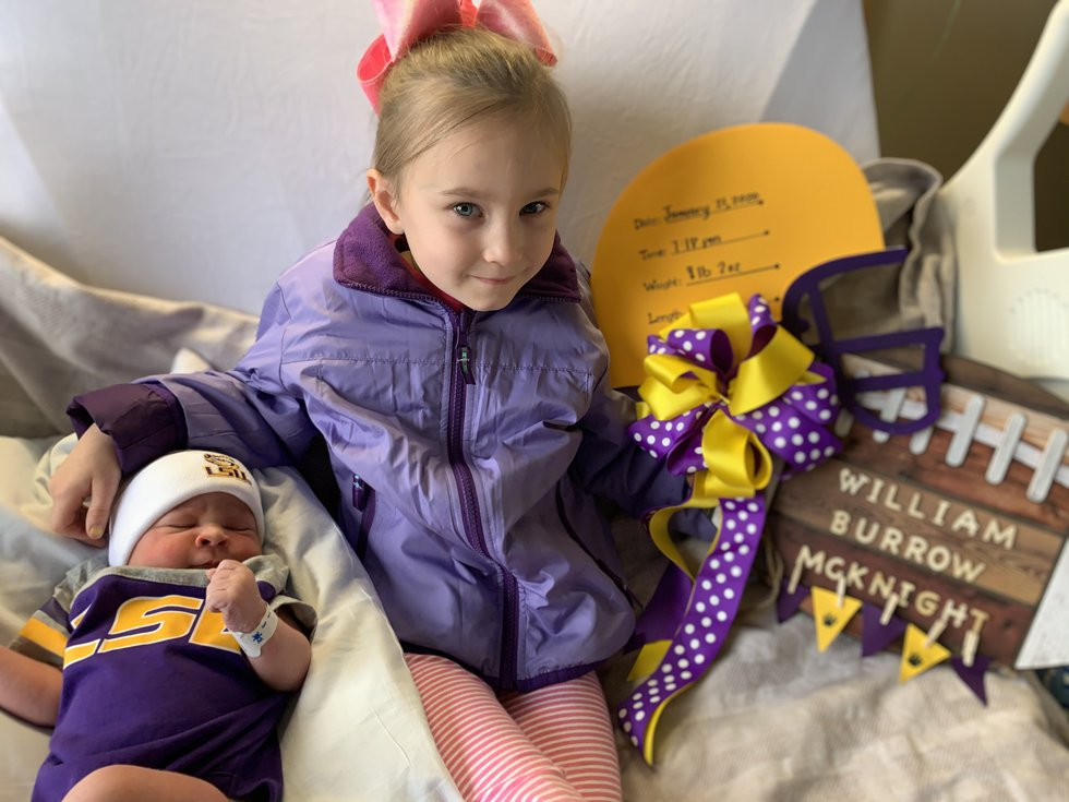 6-year-old Emile McKnight poses for a photo with her newborn brother William Burrow McKnight