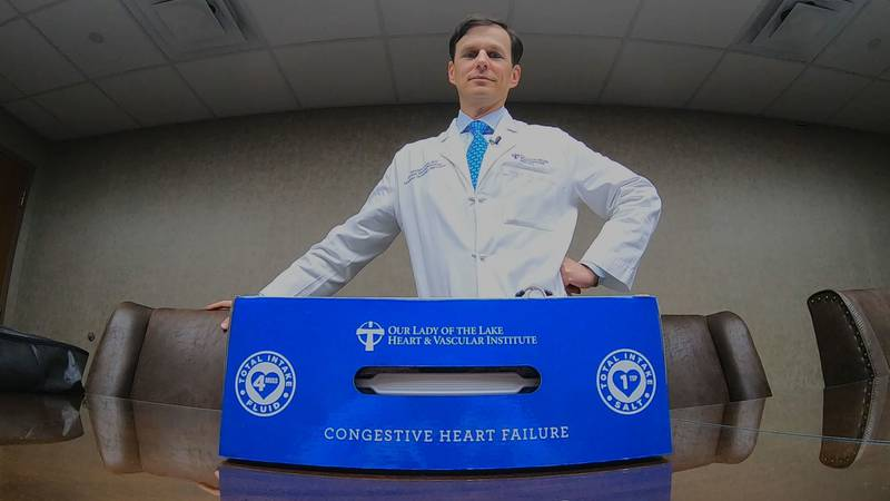 In this photo, Dr. Kenny Civello is pictured with the health box for heart patients.