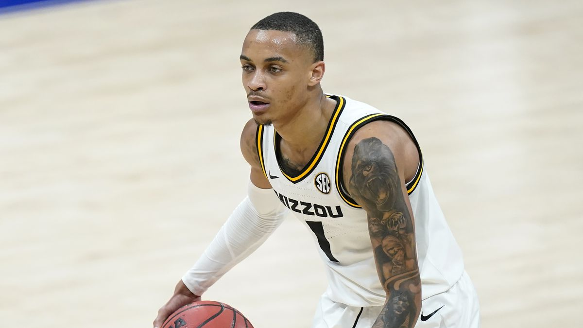 Missouri's Xavier Pinson plays against Georgia in an NCAA college basketball game in the...