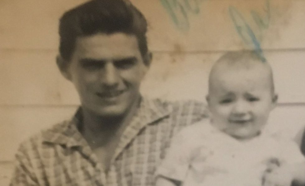 Photo of LSU football Coach Ed Orgeron as a baby with his father, Ed Orgeron senior, in the...