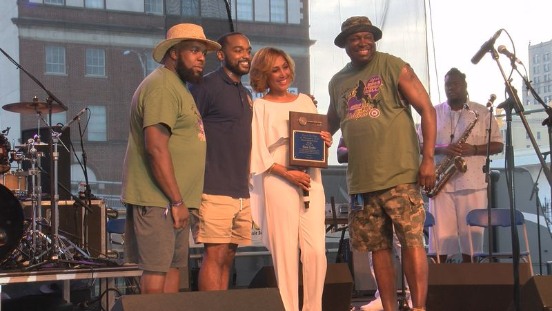 Mayor Perkins awards the Key to the City to the late Sam Cooke. His daughter accepted the award.