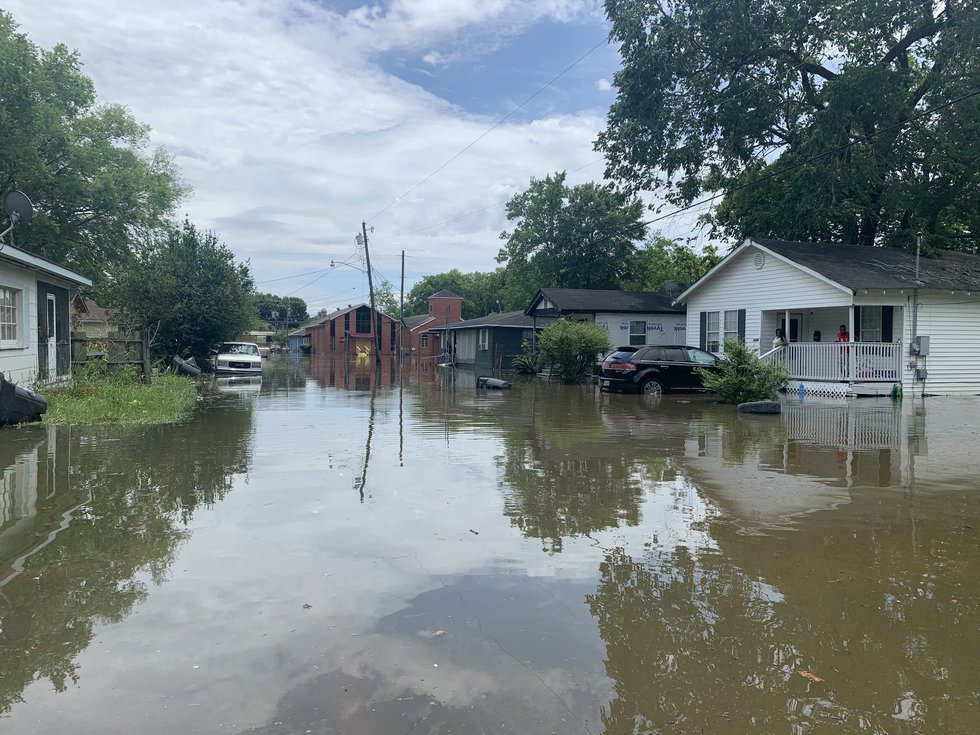 Residents on Maryland Street are surrounded by water to where they are unable to leave their...