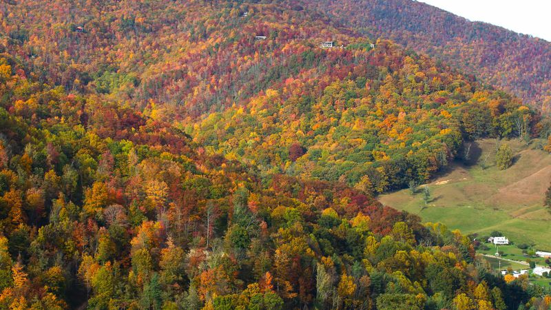 Hillsides are covered in brilliant fall colors in this October 2012 file photo.