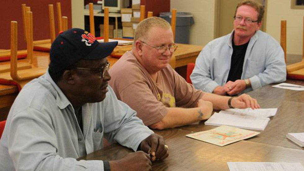 From left, offender counsel substitutes Ray Jones, Rickie Westfall and David Berry discuss...