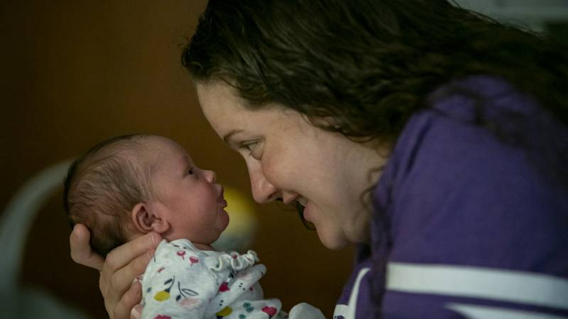 Andrea James holds her baby daughter, Lexa, after she received a lifesaving treatment for SMA.