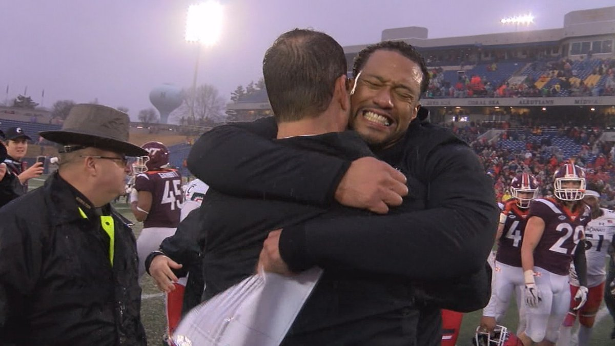 Marcus Freeman hugs Luke Fickell after UC wins the Military Bowl